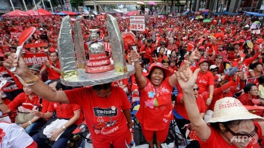 red-shirt-supporters-shout-slogans-during-a-rally-in-bangkok-on-may-19-2013-2